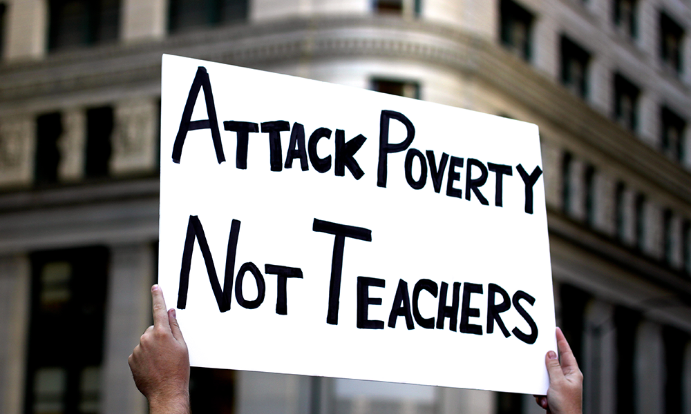 Attack poverty not teachers protest sign